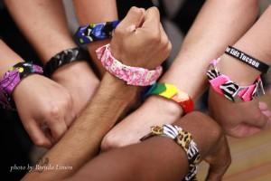 Wrists wearing duct tape bracelets