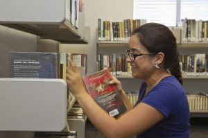 page shelving books at Sahuarita Public Library