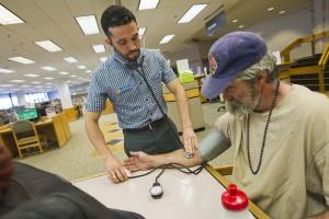 Nurse Daniel Lopez with patron