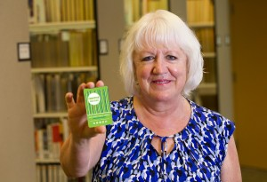 Sharon holds her Creative License library card