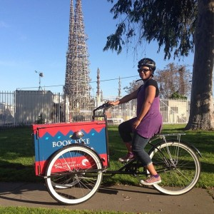 Ednita Kelly riding the Los Angeles Public Library Bookbike