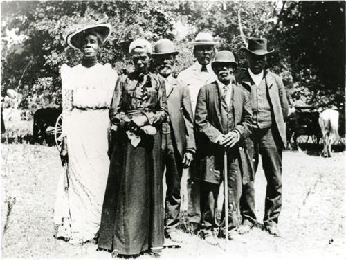 A Photo of several African Americans dressed up for a Juneteenth Celebration in 1900.