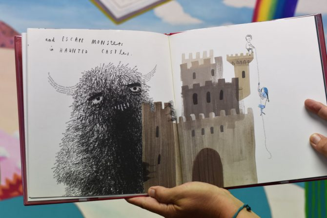 toby shows a page from the book a child of books