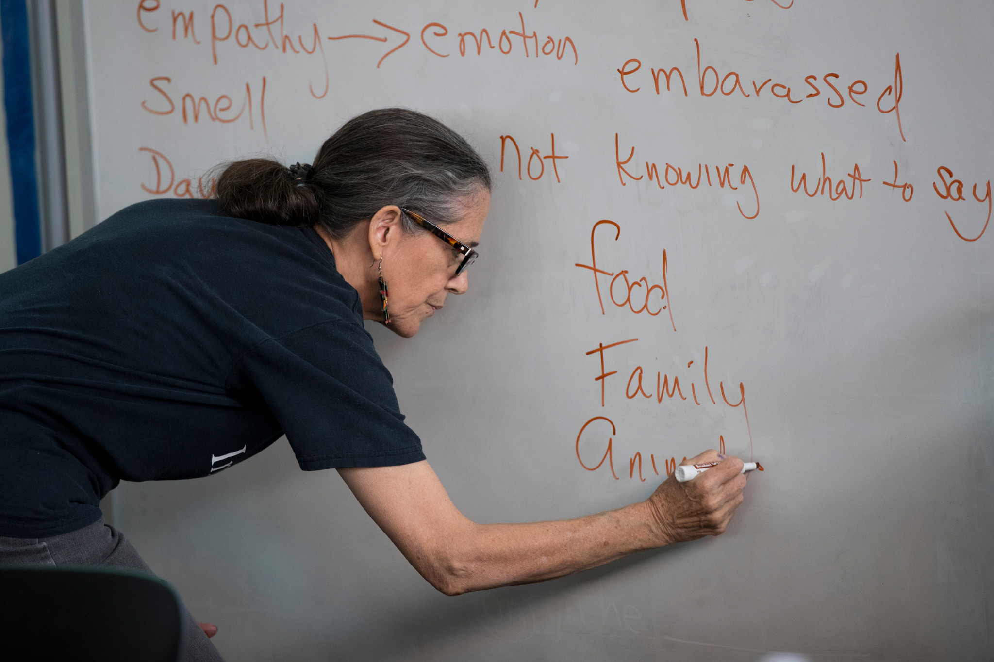 Photo of Marge Pellegrino at the whiteboard at Columbus workshop