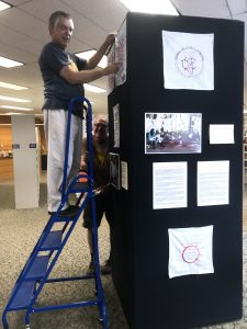 Hank Tusinski and Tim Mosman installing the exhibit.