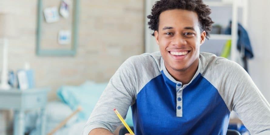 teen young man writing - rectangle