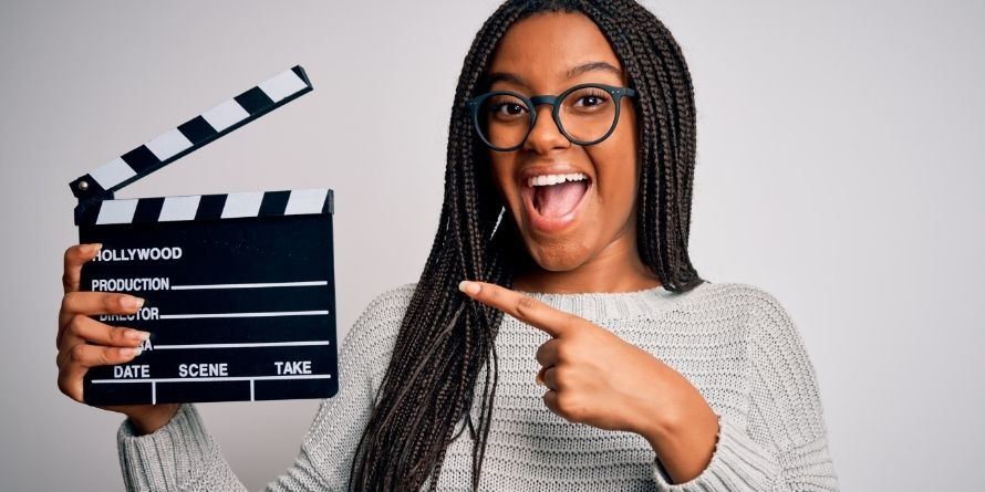 young teen female girl filmmaker with movie clapboard - rectangle